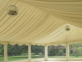 Marquee with feature lighting and pleated stock interior