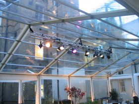 Lighting in clear roof marquee